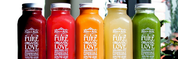 assortment of bottled juices from Sun & Soil in Sacramento