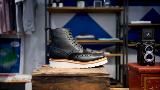 black boot on display at retail store