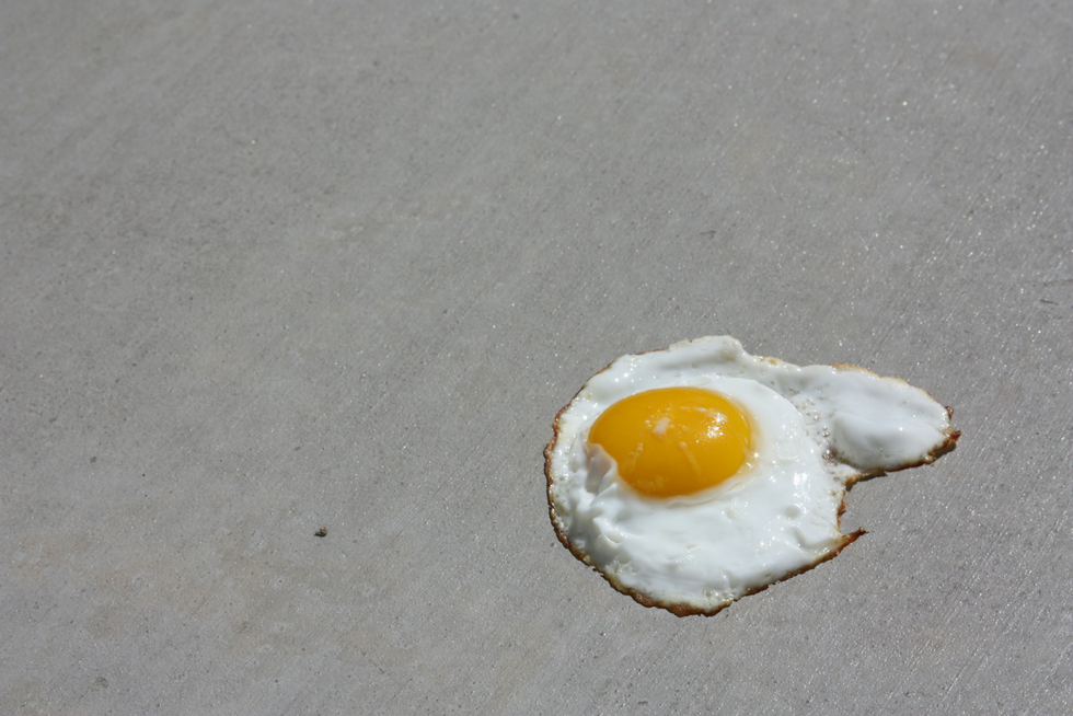 egg cooking on hot surface