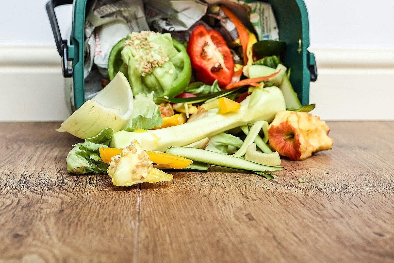 Food waste spilling out of basket in kitchen