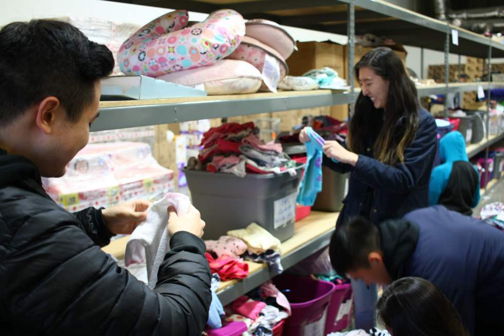 employees sorting baby clothes