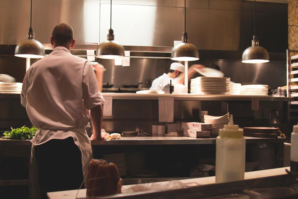 waiter in the kitchen food waste