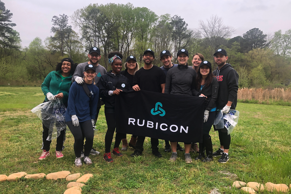 """Rubicon employees from across the Atlanta office celebrate a job well done at the annual """"Sweep The Hooch"""" Chattahoochee River cleanup event. (Image courtesy of Rubicon)"""