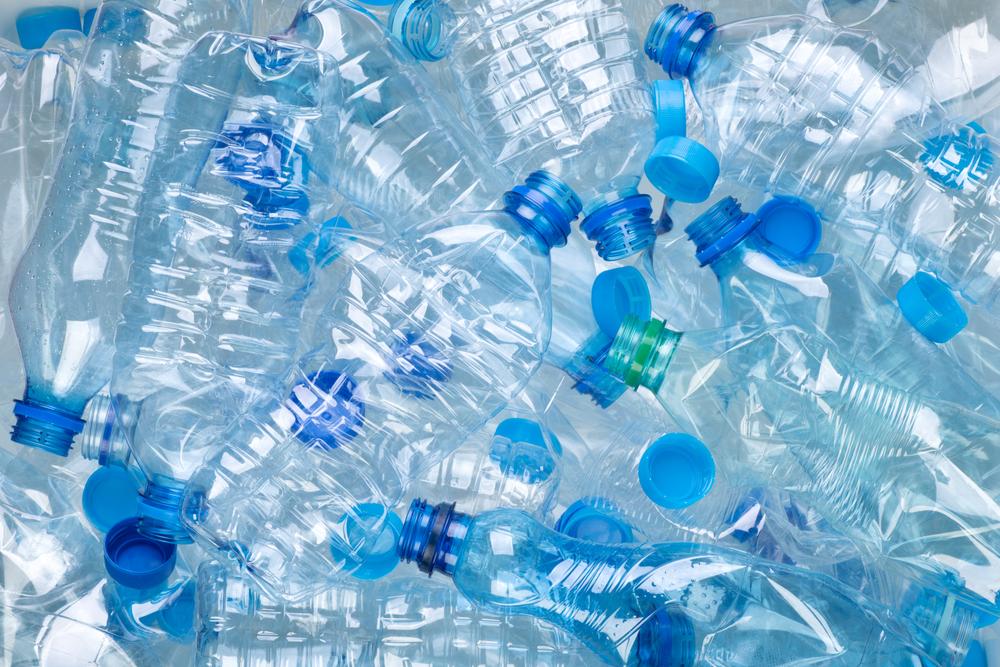 Plenty,Of,Plastic,Bottles,On,White,Background,Top,View